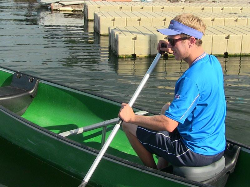 sitts in canoe